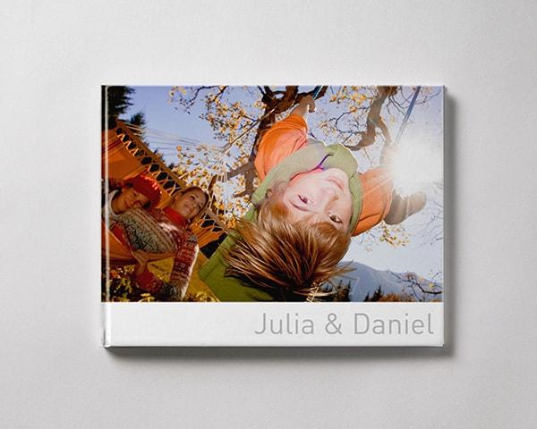 Fotobok liggande L pojke vinter familj