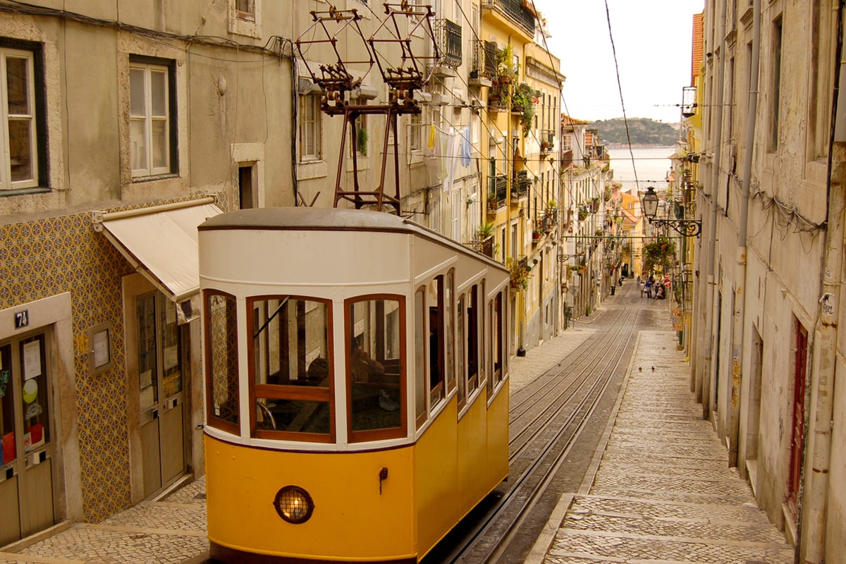 A photo of a tram in Lisbon on a sunny day.