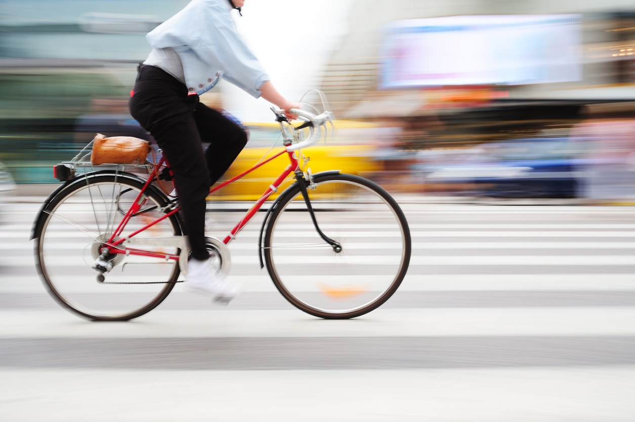 Image of a fast-moving bicycle with the background scene blurred