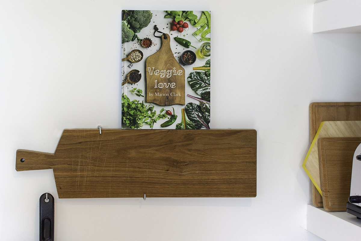 Photo book designed like a cookbook with images of recipes