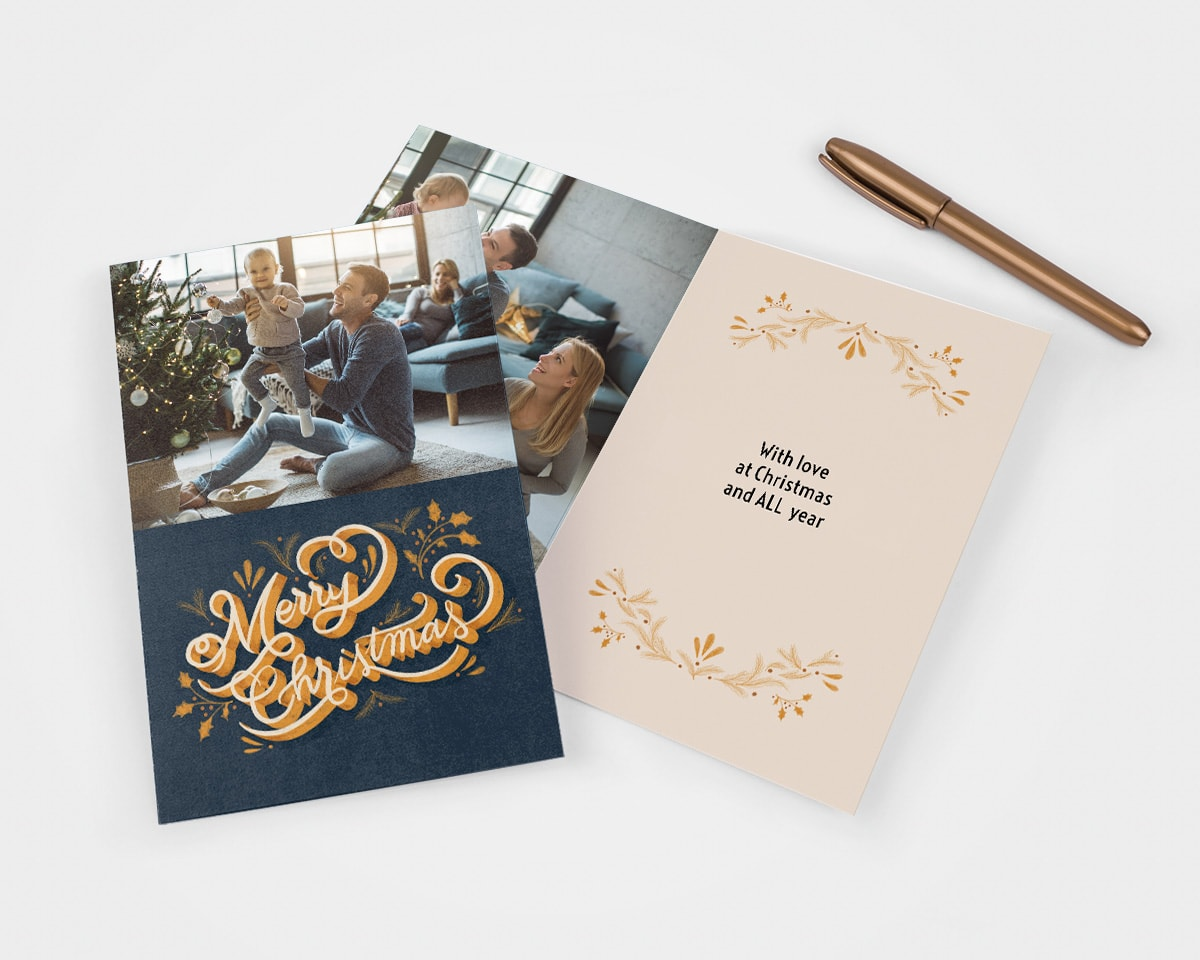 Dark blue and gold Christmas card with a family photo on