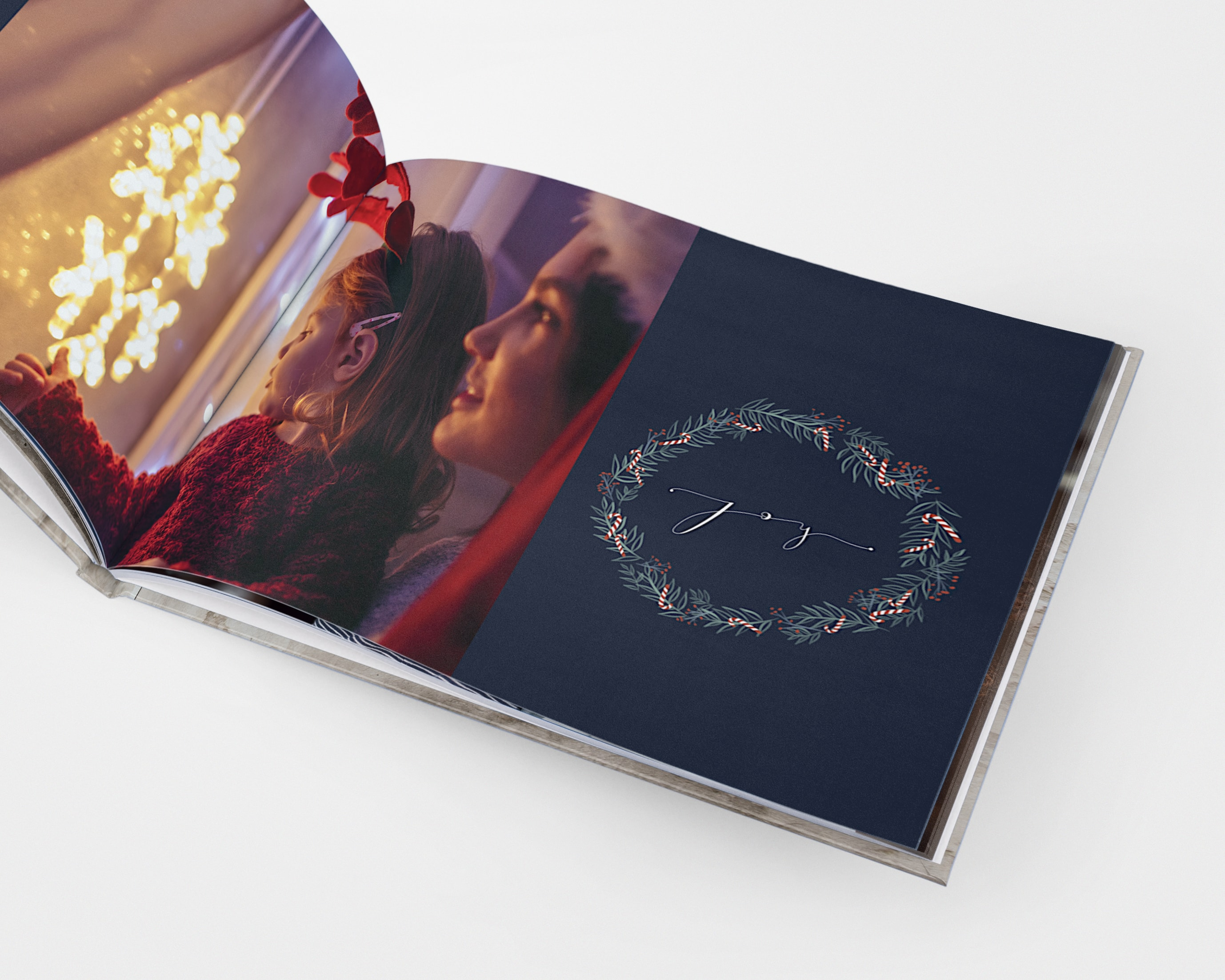 A Christmas-themed photo book with festive illustrations