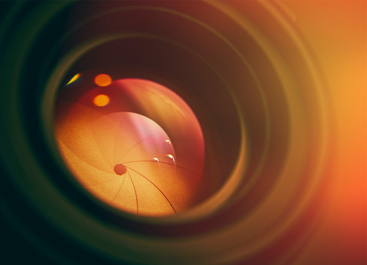 A close-up shot of a camera lens, showing the diaphragm in the lens closing.