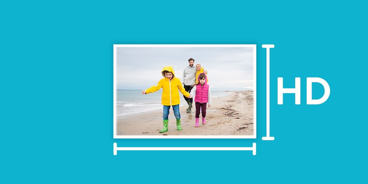 A photo of a family on the beach against a blue background labelled HD.
