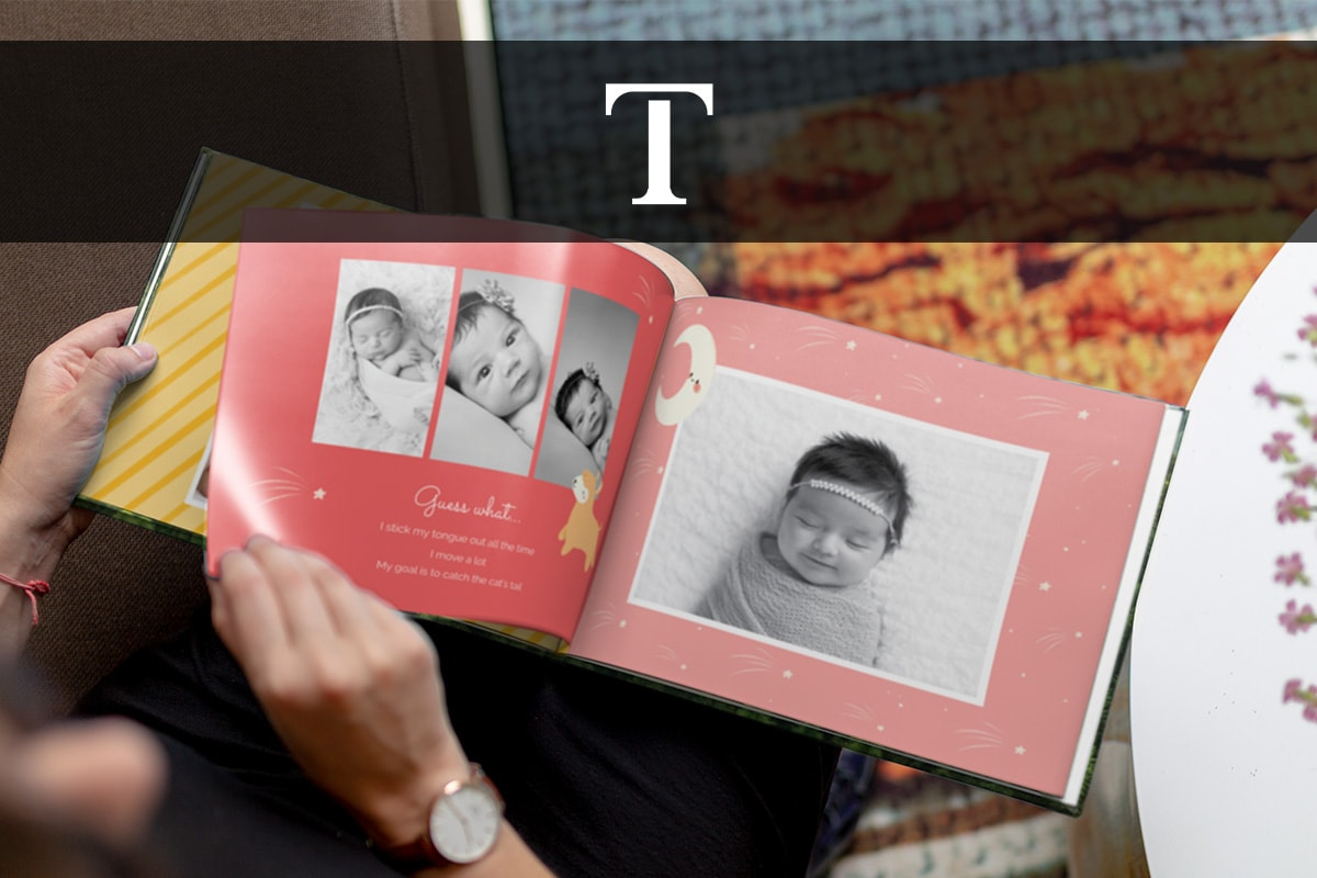 A person flicking through a pink baby book with black and white photos in and text underneath. There's a text box symbol across the top of the image.