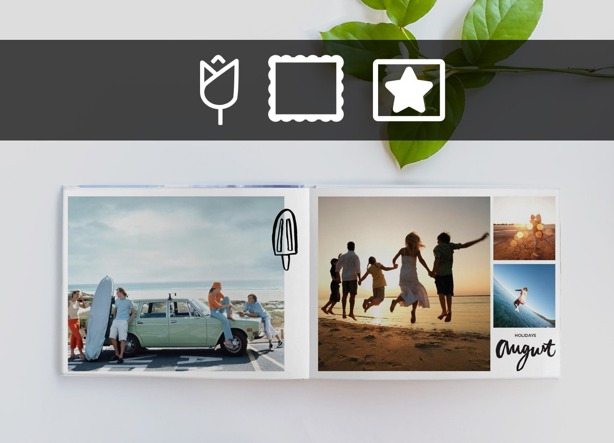 An open photo book on a white surface with beach photos in and an ice lolly illustration in the centre. There are clip art, frame and mask icons in a black bar across the top of the image.