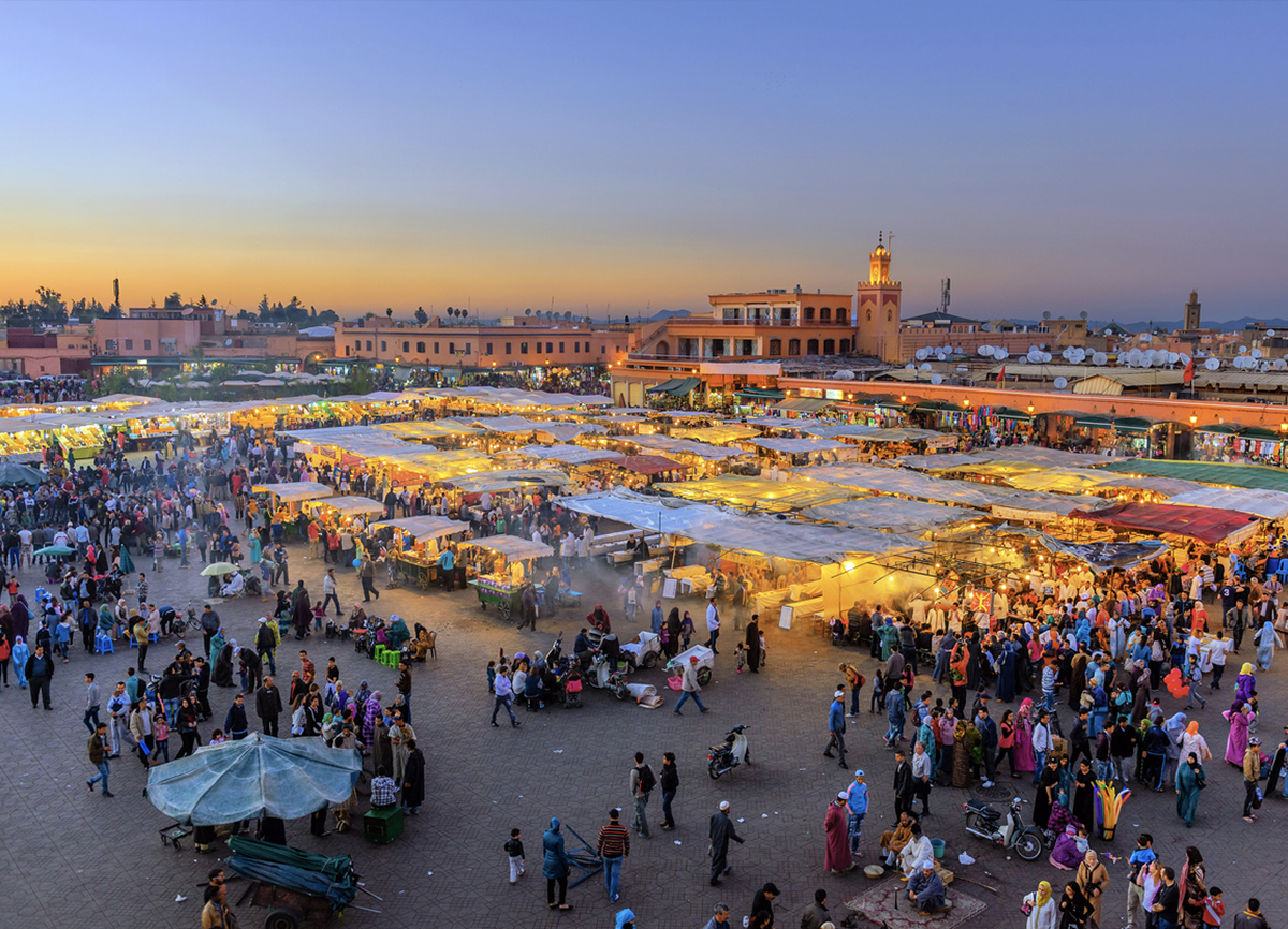 a wide shot of the whole market at dusk