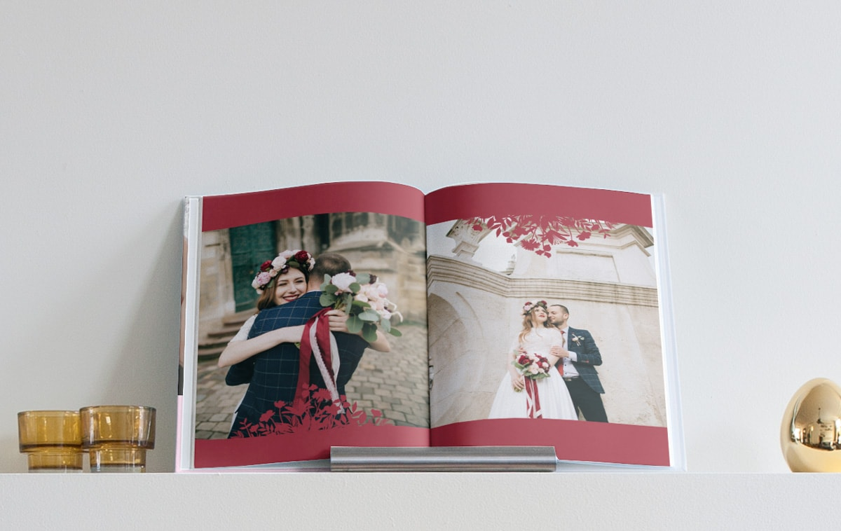 A wedding album open on a double page.
