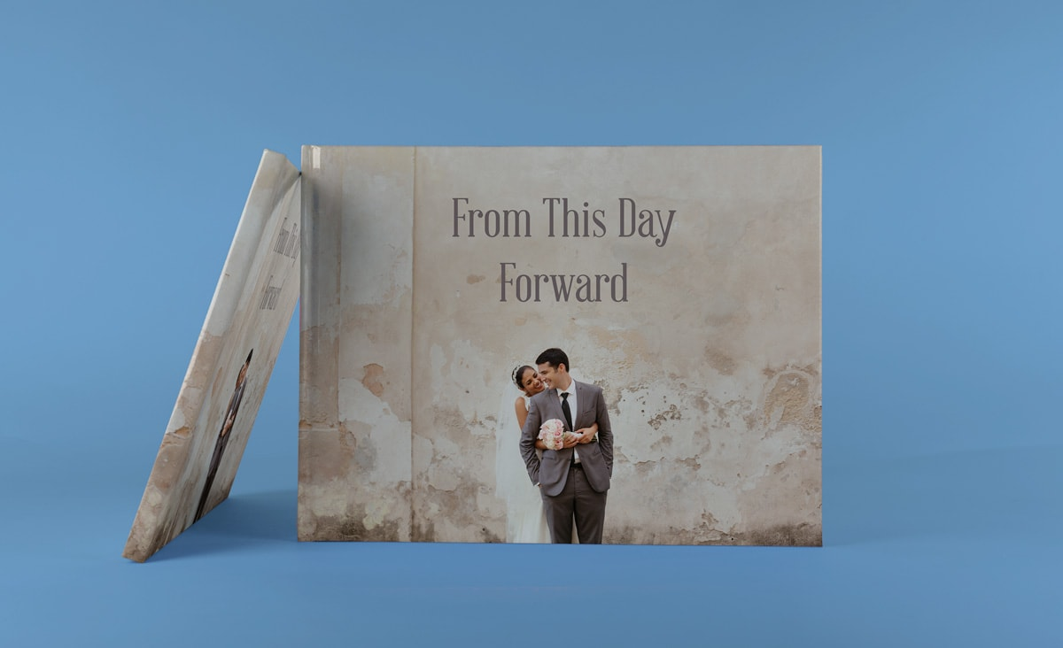 A wedding photo book with a picture of a couple on the front with the title 'from this day forward' on the cover.