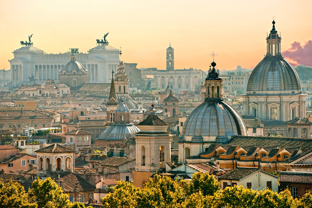 A photograph of rooftops in Rome at sunset.