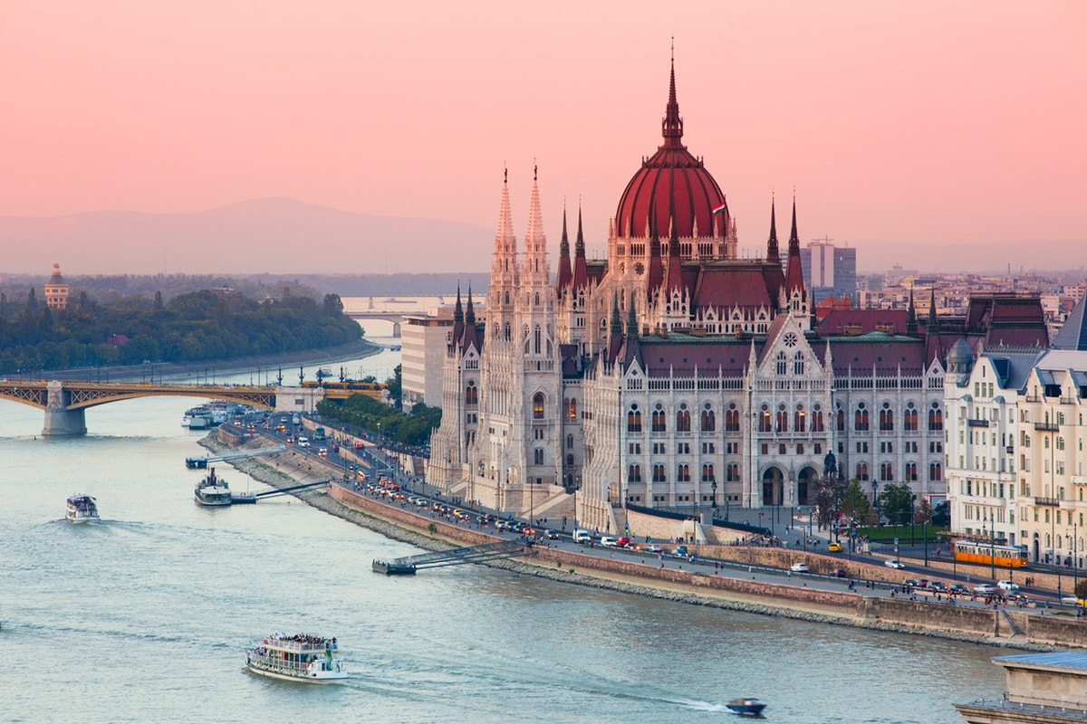 A photo of the Hungarian parliament building in Budapest by the river.