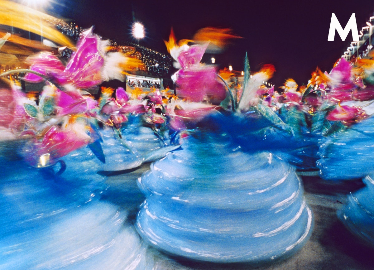 A slow shutter speed photo of a Rio carnival taken at night.