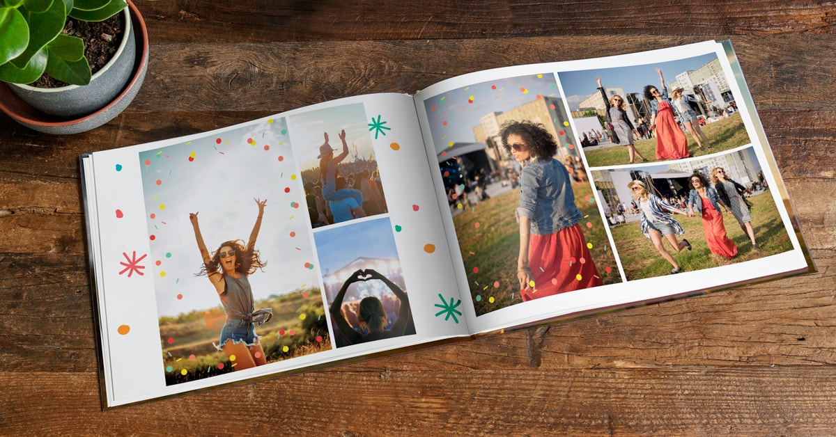 A photo book open on a double page, showing photos from a festival. The pages are decorated with confetti clip art.