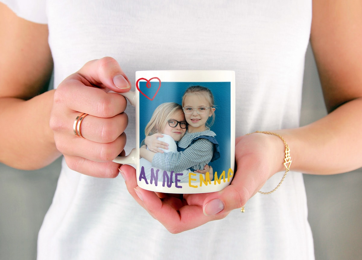 Photo mug customised with a picture of two girls and their names handwritten in marker