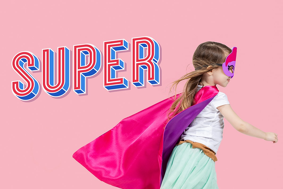 A little girl wearing roller skates, against a pink backdrop, dressed as a superhero in a pink cape, with 'super' in typography in the background.