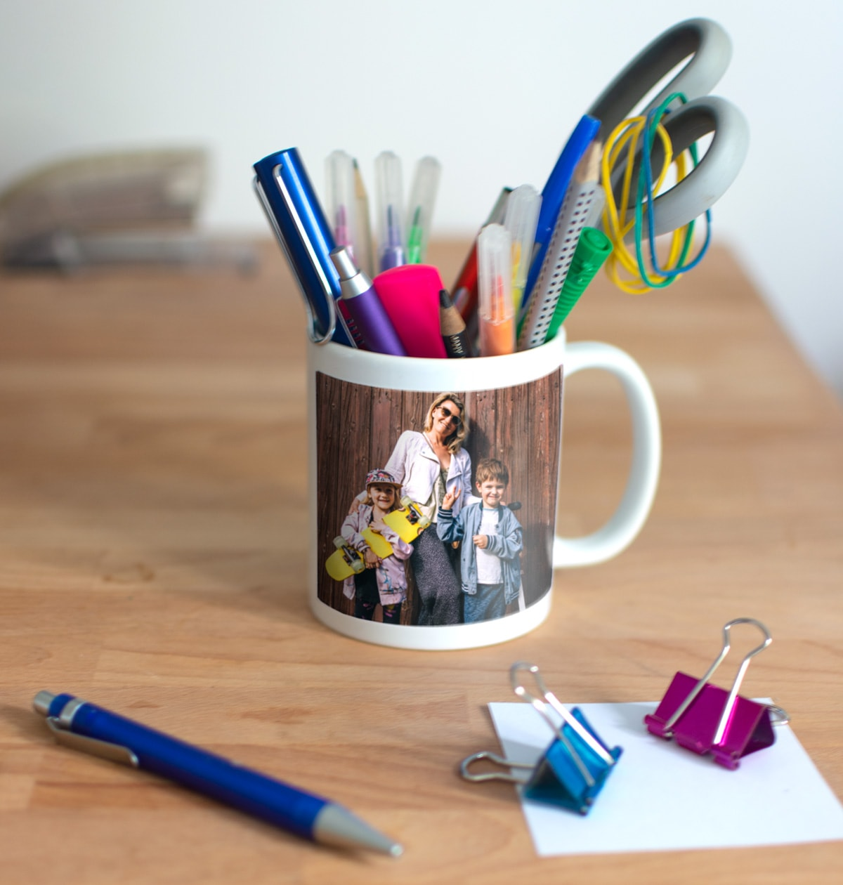 Two photo mugs used as make-up brush holders to tidy a dressing table