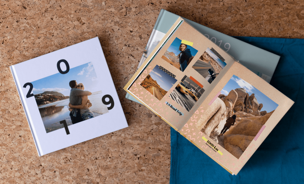 Photo book customised with clip art and backgrounds