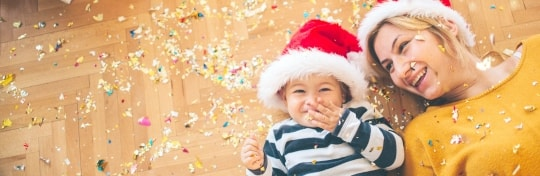Christmas cards banner for mobile, showing child at Christmas